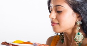 Turmeric-young-indian-woman-holding-a-plate