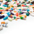 Many colorful medicines. Pills and capsules on white background